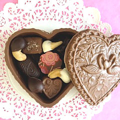 Edible Chocolate Heart-Shaped Boses filled with assorted chocolates, caramels, chocolate-covered cashews and more